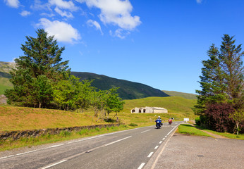 2 bikers riding on the mountainous A87 road in Scotland
