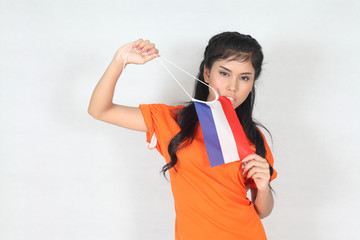 Beautiful woman with ducth flag in her hand