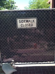 construction fence sidewalk closed sign