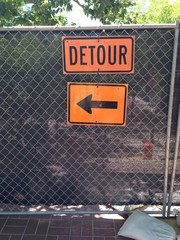 construction fence detour sign