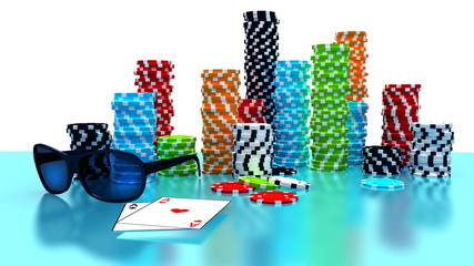 Poker Chips, sunglasses and cards on a gaming table.