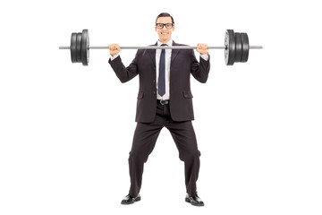Businessman holding a heavy weight