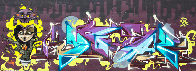 Purple graffiti on  legal wall in public skatepark