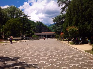 panoramic view of train station and public gardens in Trento