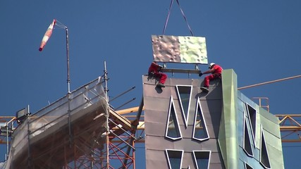 Construction workers on the tower of the Holy Family church