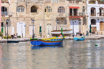 fishermen boat in Spinola bay at Malta