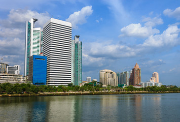 Modern buildings on blue sky with lake