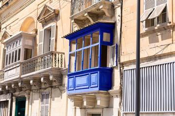 blue wooden balcony in the Malta town
