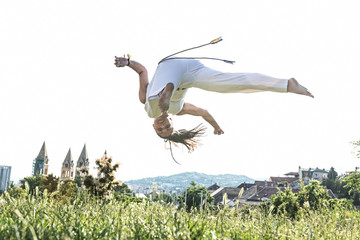 Capoeira woman, awesome stunts in the outdoors