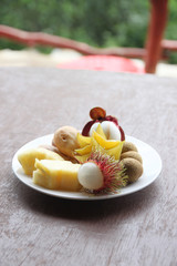 Fresh mix fruit in dish.