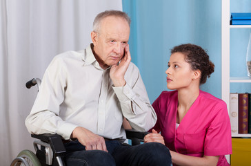 Disabled talking with a nurse and grieves