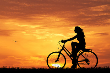 girl on bike at sunset