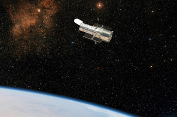 The Hubble Space Telescope observes deep space.