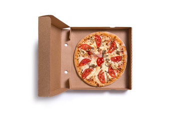 Delicious Italian pizza with ham and tomatoes in box
