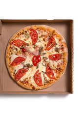 Tasty Italian pizza with ham and vegetables in box