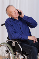 Disabled man talking on the phone