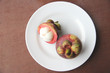 Fresh mangosteen fruit of peeling in dish.