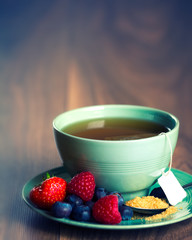 Cup of fruit tea with berries with copy space