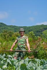 Gardener with hoe 13