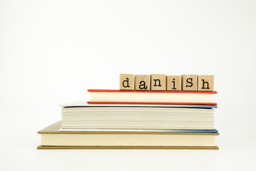 danish language word on wood stamps and books