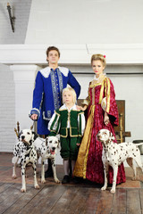 Father, mother and son in bright medieval costume pose