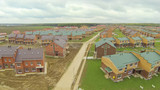 New townhouse village with incomplete cottages. poster