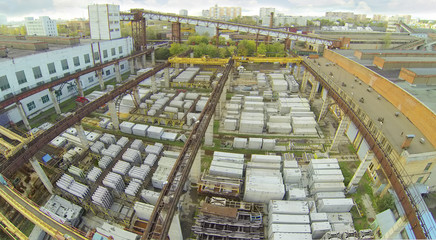 Top view of warehouse with construction materials near factory.