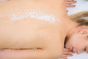 Close-up of woman with salt crystals back