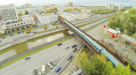 City panorama with overground subway train.