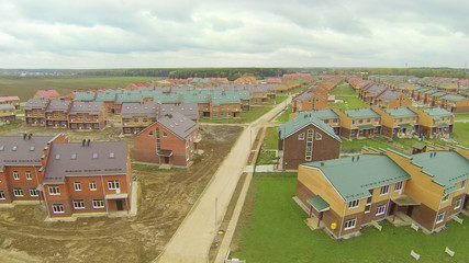 New townhouse village with incomplete cottages.