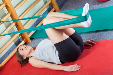 Fit woman exercising in fitness studio