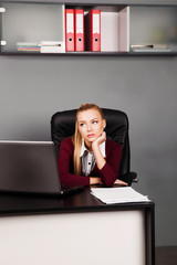 Beautiful businesswoman tired from work in the office.