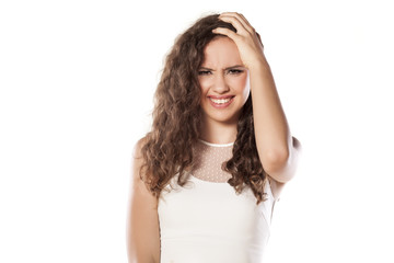 beautiful confused girl on white background