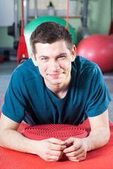 Man having a break from physical exercises