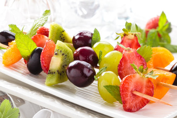 fresh summer fruits on sticks.