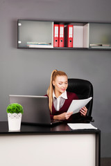 beautiful businesswoman typing on laptop at her desk