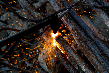 Sparks during cutting of steel pipes with acetylene torch