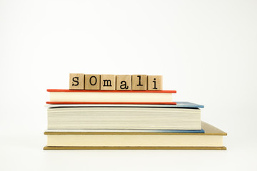 somali language word on wood stamps and books