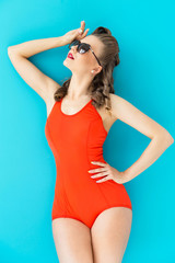 Pinup. Girl in red swimsuit