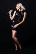 Beautiful blonde singing woman with microphone. Singer. Karaoke