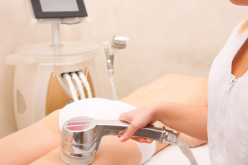 Woman getting light pulsed hair removal treatment