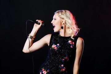 Beautiful singing woman with microphone. Singer. Karaoke song.