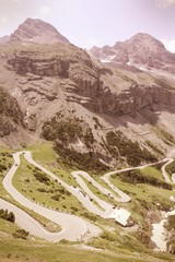Stelvio Pass in Italian Alps. Cross processed color tone.