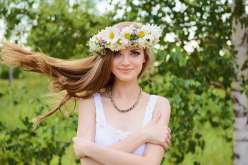 happy young beautiful woman with blue eyes standing in the wind