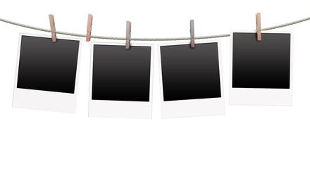 Polaroidfotos an Wäschleine aufgehangen