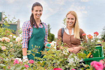 Shop assistant and customer in garden center