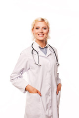 Smiling medical doctor woman with stethoscope. on white