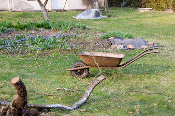 preparation for spring work, wheelbarrow in yard