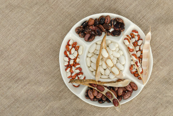 colorful bean in plate on linen texture background