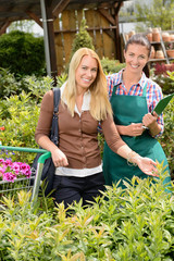 Garden center worker and woman customer shopping
